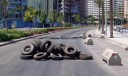 Remnants of a roadblock and burnt tyres